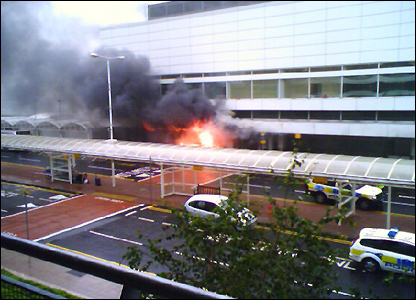 An image of billowing flames from the burning car