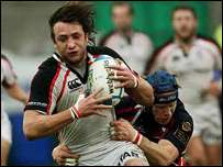 Ulster's Neil Best is tackled by Simon Easterby