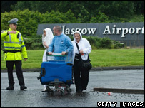Passengers and police at Glasgow Airport