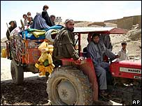 A tractor leaves the village of Hyderabad for Gereshk on 30 June