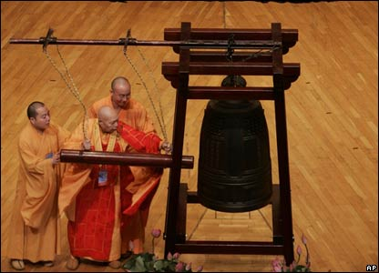 A Buddhist monk tolls a special bell in Hong Kong moments before midnight on 1 July, 2007