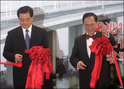 President Hu Jintao and Hong Kong Chief Executive Donald Tsang attend a ribbon-cutting ceremony at the newly inaugurated Shenzhen Bay Bridge.