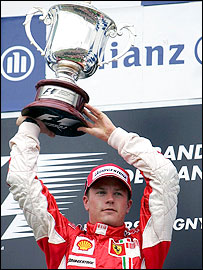 Kimi Raikkonen celebrates his victory in the French Grand Prix