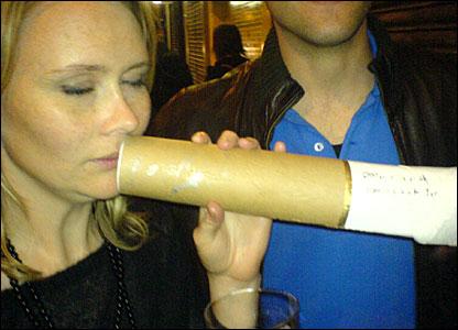 Tessa Hewson smoking an oversized cigarette