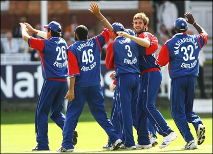 England celebrate the wicket of Chris Gayle