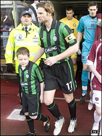 Celtic captain Steven Pressley takes to the Tynecastle pitch