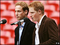Prince William and Harry on stage at Wembley