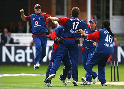England celebrate the run out of Devon Smith