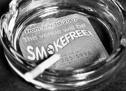 Ashtray with flyer warning of the ban visible