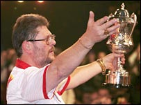 Martin Adams celebrates with his winning trophy