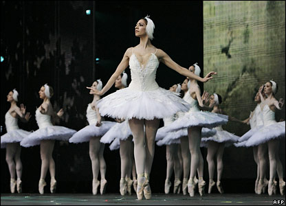 Members of the English National Ballet performs an extract from Swan Lake