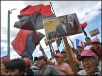 Sandinista supporters wave flags and photos in the Cuba Libre neighbourhood of Managua