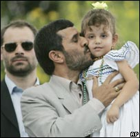 Iran's Mahmoud Ahmadinejad kisses a little girl during a visit to the Cuba Libre neighbourhood of Managua