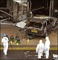Forensic officers near burnt vehicle