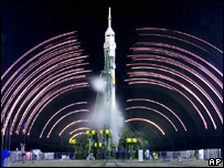 Long exposure of gantry retraction preparations; Soyuz on launch pad (AP)