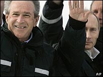 President Bush (left) and President Putin wave
