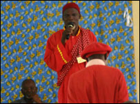 A prophet from the ethnic Kongo people dressed in a silky red