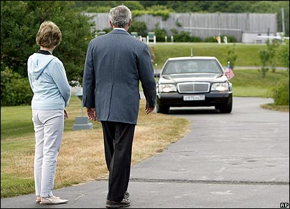 President Bush and Laura Bush watching Mr Putin's car arrive