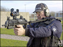Ministry of Defence officer with weapon