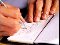 A man writes a cheque