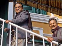 Maoist rebel leader Prachanda, left, and his deputy Baburam Bhattarai arrive at parliament