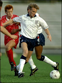 Geoff Thomas in action for England