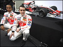 Lewis Hamilton and Fernando Alonso pose with the new McLaren MP4-22