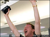 Jay Miller reacts after buying his iPhone in Houston, TX