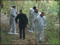 Forensic teams searching the area where Mr Luffman's body was found
