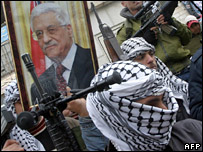 Fatah gunmen with portrait of Mahmoud Abbas