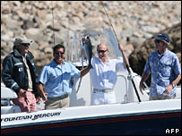 Presidents George Bush Senior, Vladimir Putin and George W Bush on a fishing trip