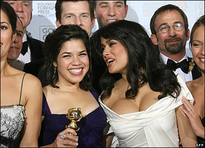 America Ferrera and Salma Hayek with the cast of Ugly Betty