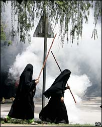 Female madrassa students armed with sticks, 3 July