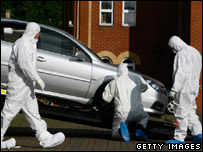 Forensic investigators removing the car