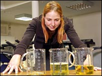 Dr Alice Roberts with urine samples