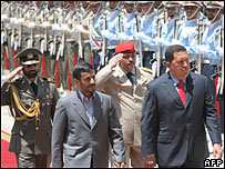 Iranian President Mahmoud Ahmadinejad and his Venezuelan counterpart Hugo Chavez review the honour guard in Tehran.