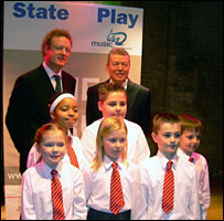 Howard Goodall, Alan Johnson and some members of Hunters Hall Primary School choir