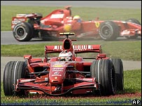 Kimi Raikkonen goes off on to the grass in Canada as team-mate Felipe Massa goes past behind him