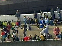 Passengers outside the airport
