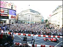 Luca Badoer drives a Ferrari through London's Piccadilly Circus in 2004