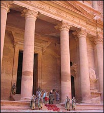 Costumed people outside the Treasurer's House in Petra