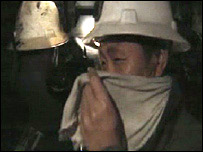 Chinese mine worker covers his face with a scarf (Archive picture)