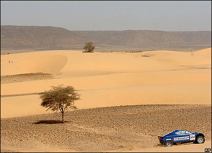 France's Jean Louis Schlesser and co-driver Arnaud Debron steer their Ford buggy during the ninth stage of the Dakar rally between Tichit and Nema, Mauritania