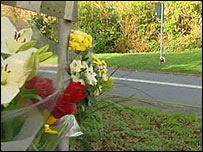 Floral tributes at the scene of the crash last January
