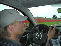 Heikki Kovalainen takes BBC reporter Sarah Holt around Silverstone in a Renault road car