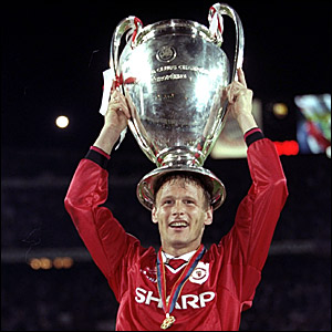 Teddy Sheringham holds the Champions League trophy aloft