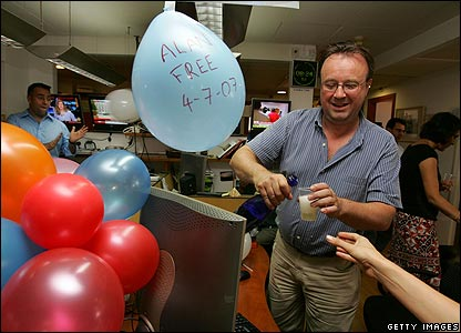 BBC staff celebrate the release of Alan Johnston with balloons and champagne