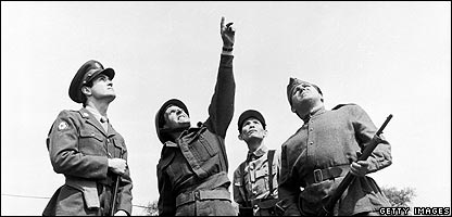 Personnel pointing in the air