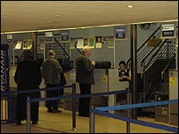 People waiting to check in at Bournemouth Airport