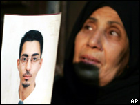 The mother of Dr Mohammed Asha with a picture of her son